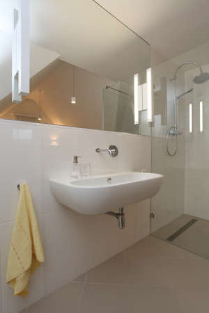 Bathroom with huge mirror and bright tiles photo
