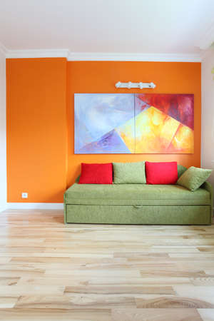 Modern room with colorful wall and sofa photo