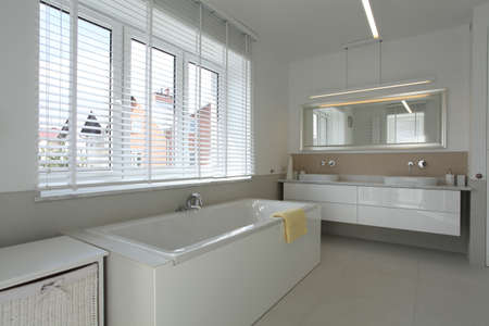 well equipped: White spacious bathroom in contemporary house