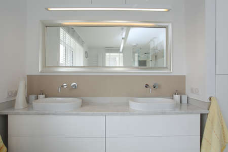 well equipped: Bright and modern bathroom, sink and mirror