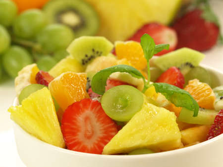 lowfat: Closeup of sweet fruit salad in white bowl