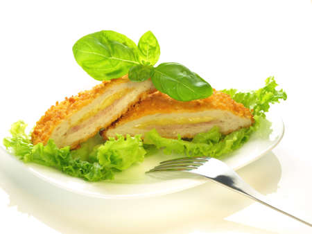 cordon: Cordon bleu cut in half on isolated background