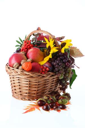 Wicker basket full of autumn stuff, isolated background Stock Photo - 15615352