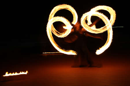 fire show: Original spiral with fire at night show Stock Photo