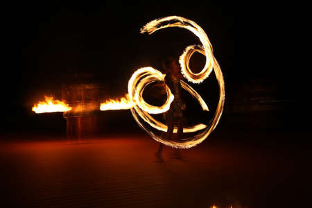 fire show: Fire show in night with a professionals
