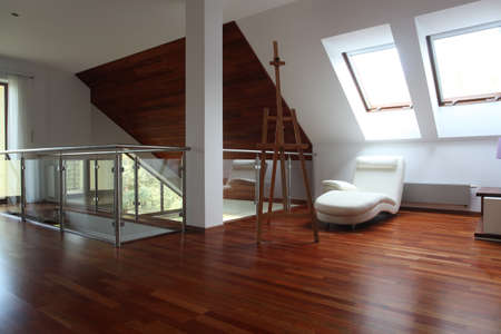 comfortable chair: Contemporary artist apartment with easel and comfortable chair