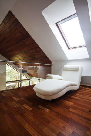 Wooden attic with comfortable chair, stylish mezzanine Stock Photo - 15784251