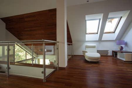 Mezzanine with wooden floor and white walls
