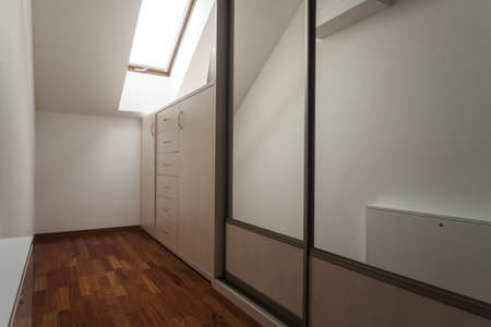 Dressing room on the attic, wardrobe, modern house photo