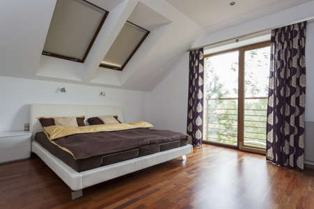 cosy: Elegant and modern bedroom with a balcony Stock Photo