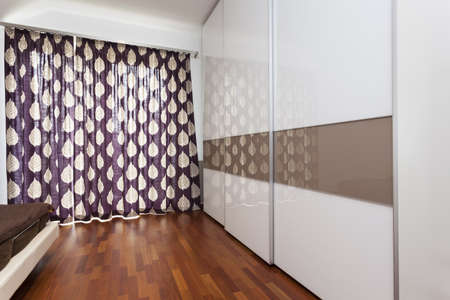 Huge built-in wardrobe in contemporary bedroom photo