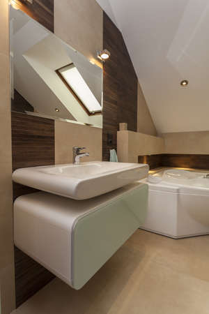 Stylish bathroom: washbasin, bath and mirror photo