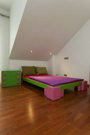 Modern bedroom in apartment with colorful furniture Stock Photo - 15784258