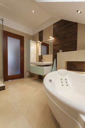Bathroom interior: bathtub, mirror and a sink photo