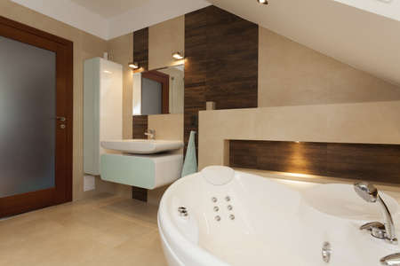 Interior of contemporary bathroom with white bathtub photo
