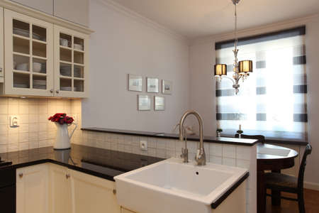 Kitchen with farmhouse sink and round table photo