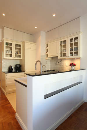 buffet table: New modern kitchen with bright furniture Stock Photo