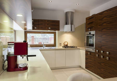 kitchen appliances: Interior of modern, stylish kitchen with wooden cupboards Stock Photo