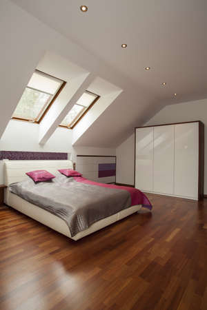 Spacious modern bedroom with pink pillows photo