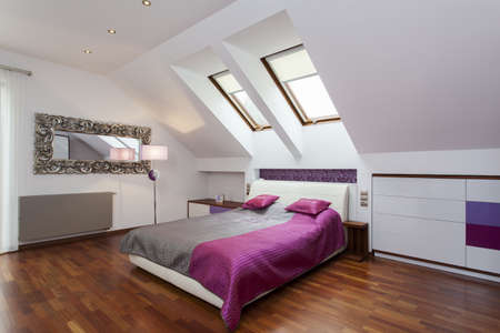 attic: Modern bedroom in the attic of contemporary house