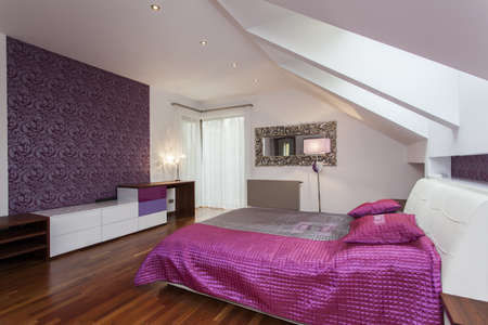 White and purple bedroom with patterned wall