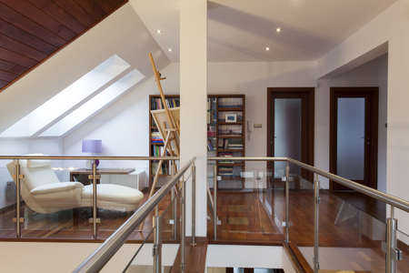 entresol: Attic with easel and painting in artists house
