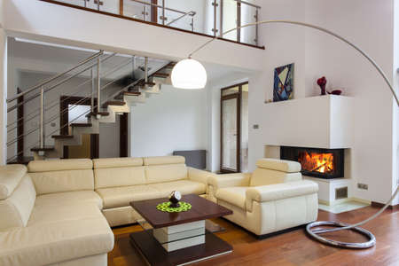 fireplace living room: Big and comfortable living room with bright sofa