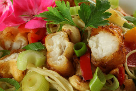 Fish fillet in a chinese colorful salad photo