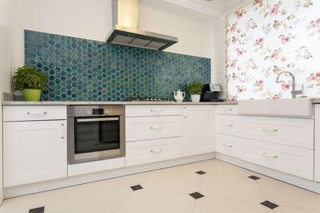 interior designer: Modern elegant kitchen with turquoise wall