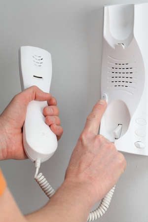 intercom: Pushing the button of the entry phone, opening the door