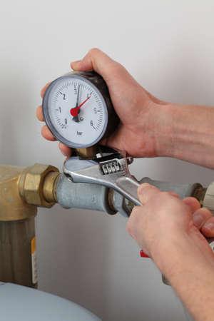 screwing: Screwing pressure gauge Stock Photo
