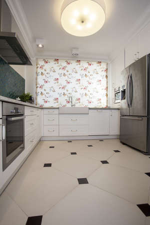 Interior of kitchen with flowery blinds photo