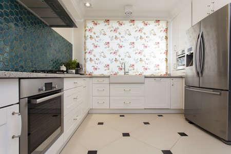 window blinds: Bright kitchen interior in modern stylish house