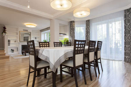 dining table and chairs: Elegant prepared table in stylish dining room