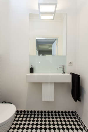 Sink and mirror in toilet, modern house photo