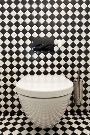 furnish: Toilet with a checkered pattern wall, closeup