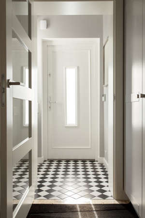 Elegant white corridor in a modern house photo