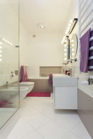 Lighted romantic bathroom in modern style photo