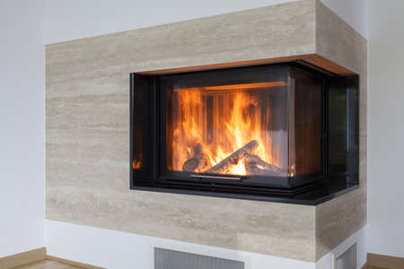 Closeup of fireplace made with a travertine photo