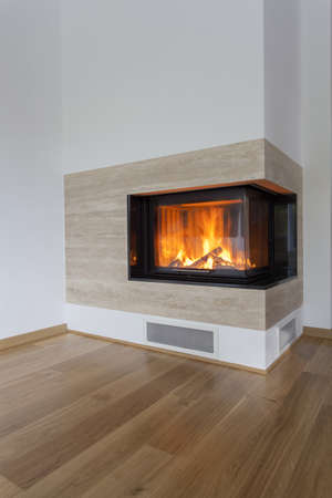 travertine house: Vertical view of fireplace with burning wood