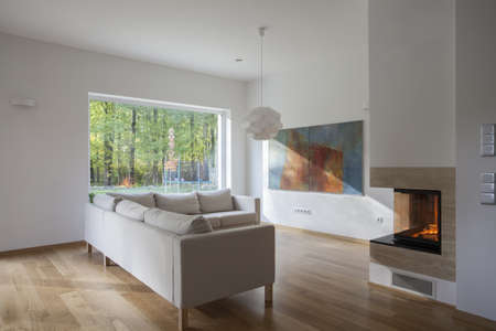 Modern, spacious living room with huge window Stock Photo - 16164877