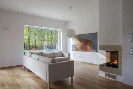 Modern, spacious living room with huge window Stock Photo - 16164877