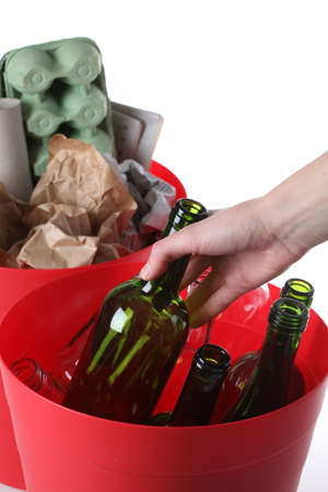 Putting glass bottles into bin, isolated white background Stock Photo - 16250985