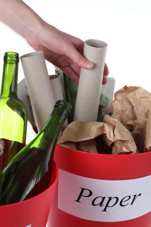 Putting paper garbage into recycling bin, closeup Stock Photo - 16250993