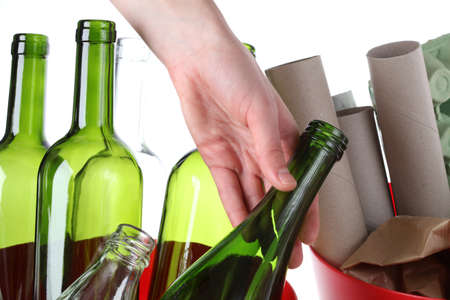 Glass bottles and paper garbage, recycling bin Stock Photo - 16250999