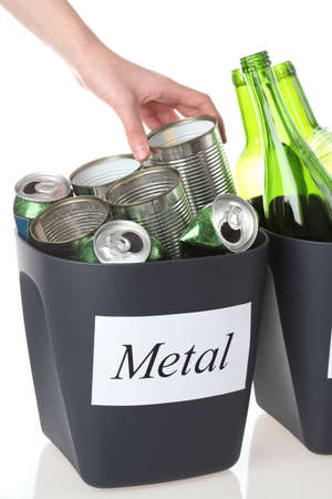 discarded metal: Recycling: putting metal cans into bin, isolated