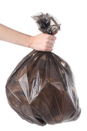 discarded metal: Plastic bag full of garbage on isolated background Stock Photo