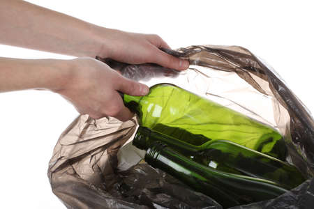 Putting glass bottles in a plastic bag, recycling Stock Photo - 16302975