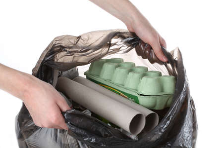 Plastic bag full of paper garbage, isolated background Stock Photo - 16302976