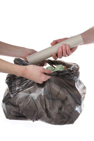 Plastic bag full of paper rubbish, isolated background photo